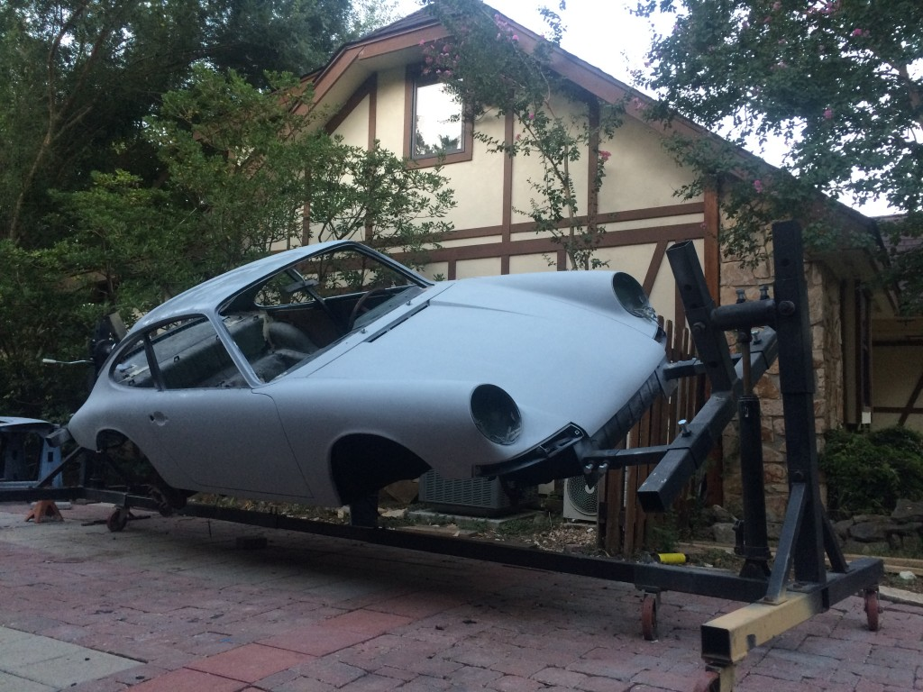 Porsche 911 on the rotisserie for chassis restoration.